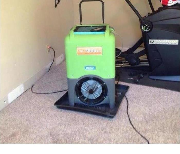 dried out carpet with a SERVPRO drying machine on top