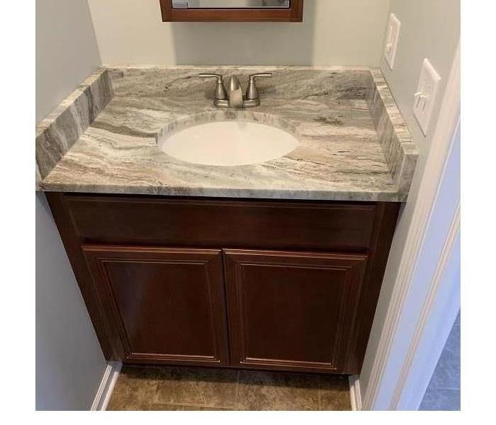 a bathroom sink that has been restored