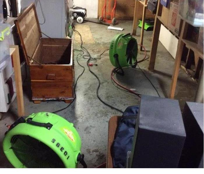 basement that has been remediated by SERVPRO with SERVPRO green dehumidifiers