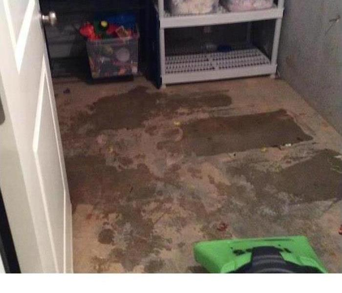 concrete floor that has been dried after water damage had occurred